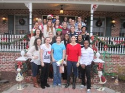 "Fordham's 2012-13 basketball team celebrates the holidays at ""team mom"" Donna Collins's home in Hamilton, N.J."